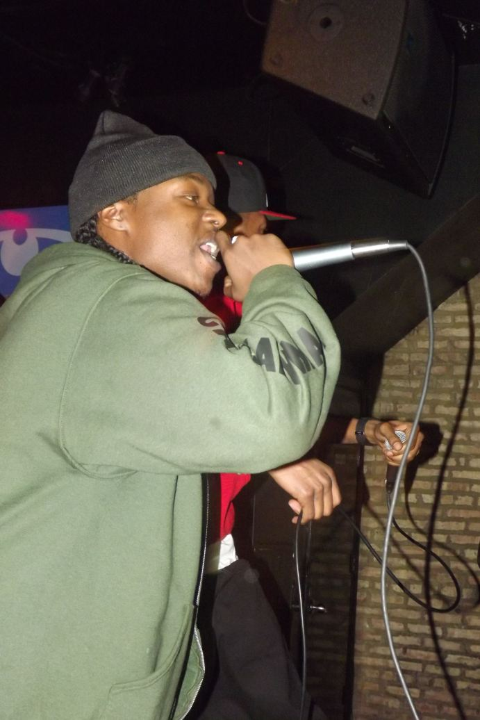 Poo Mack, Artist and CEO of Pilot High Clothing Gear) spits a verse while performing with Paris Beuller at The Chi City Record Pool Showcase